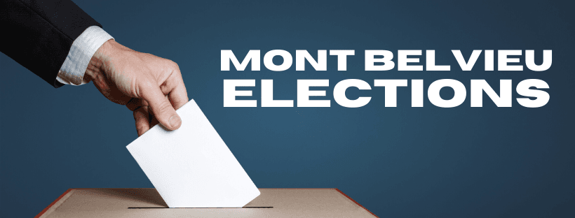A hand putting a ballot in a voting box. Mont Belvieu Elections